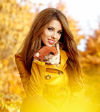 Woman  in a park in autumn Stock Image