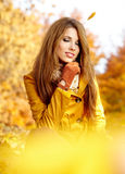 Woman in a park in autumn Stock Images