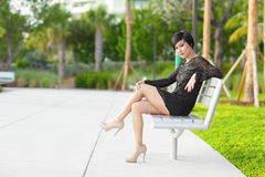 Woman on the park bench Royalty Free Stock Photography