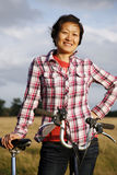 Woman in the park with bicycle - 03 Stock Photography
