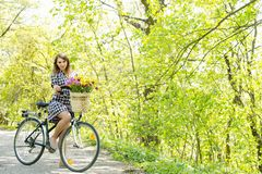 Woman in the park on a bike stock images