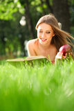 Woman in the park with book Stock Photo
