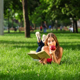 Woman in the park with book Stock Photography