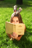 Woman in the park with book Royalty Free Stock Images