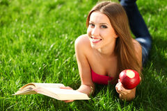 Woman in the park with book Royalty Free Stock Photo