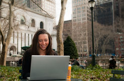 Woman in a Park With a Computer Stock Photos