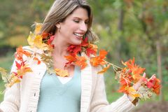 Woman in a Park, Fall, Seasonal Theme Stock Photo