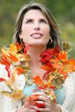 Woman in a Park, Fall, Seasonal Theme Royalty Free Stock Images