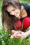 Woman in park gather spring flowers. Pretty woman in park gather spring flowers, outdoor stock photos
