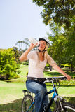 Woman in the park with her bike Stock Photo