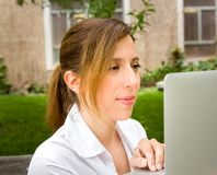 Woman in park with her computer Royalty Free Stock Photos