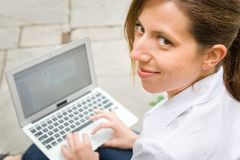 Woman in park with her computer Stock Photography
