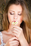 Woman in park holding spring flowers Royalty Free Stock Images