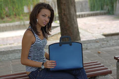 Woman in park with laptop stock image