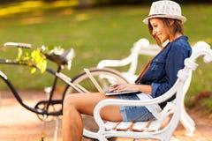 Woman park laptop Stock Photography