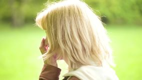 Woman in park looking at camera stock footage