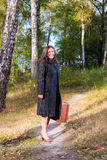 Woman in the park with old fashion trunk Royalty Free Stock Photos