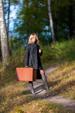 Woman in the park with old fashion trunk Stock Photos