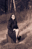 Woman in the park with old fashion trunk Stock Images