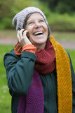Woman in park with a phone Royalty Free Stock Photo
