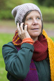 Woman in park with a phone Royalty Free Stock Photography