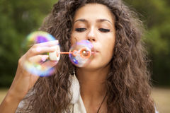 Woman in the park playing in bubbles cup Royalty Free Stock Photo