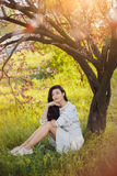 Woman in park. Pleasure of spring nature. Stock Photo