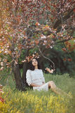 Woman in park. Pleasure of spring nature. Royalty Free Stock Images