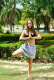 Woman in the park practicing yoga outdoors Royalty Free Stock Photo