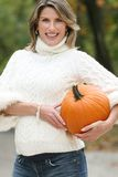 Woman in a Park with Pumpkin, Fall, Seasonal Theme Royalty Free Stock Photos