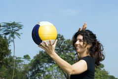 Woman at Park Spiking Volleyball - Horizontal Royalty Free Stock Photos