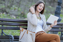 Woman in the park with tablet Stock Photo