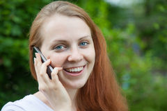 Woman in the park talking to the phone Royalty Free Stock Photos