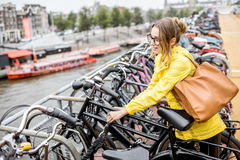 Woman parking a bicycle in Amsterdam Stock Photography