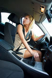 Woman parking car Stock Images