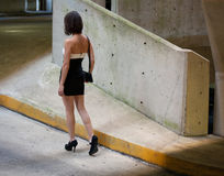 Woman in Parking Garage. An image of the back of a woman as she walks through a parking garage Stock Photography