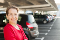 Woman in  parking lot Stock Photography