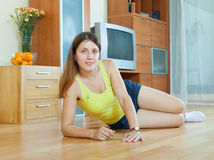 Woman on parquet floor at home Stock Image