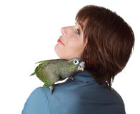 Woman with parrot on shoulder Stock Photos