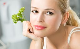 Woman with parsley Stock Photo