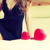 Woman part body with heart. Stock Photo