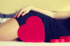 Woman part body with heart. Stock Images