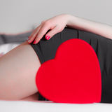 Woman part body with heart. Royalty Free Stock Images