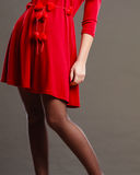 Woman part body in red dress. Royalty Free Stock Photo