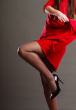 Woman part body in red dress. Stock Photo