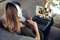 Woman participate video conference looking at laptop screen during virtual meeting, videocall webcam app for business
