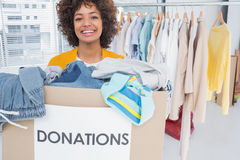 Woman participating at charity. And holding donation box Stock Photography