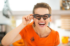 Woman in party bat glasses in the Halloween decorated kitchen Stock Photo