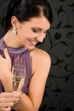 Woman party dress drink champagne glass. Glamorous look aside Stock Image