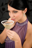 Woman party dress drink cocktail glass. Smiling look aside Royalty Free Stock Photography
